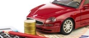 Autokosten mit Taschenrechner und Rotstift